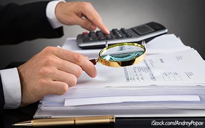 Businessperson_Examining_documents_blog_horizontal_400x250