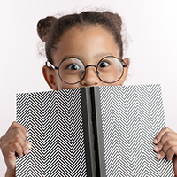 girl_with_glasses_hiding_behind_notepad_iStock-1132000025_blog_square_200x200