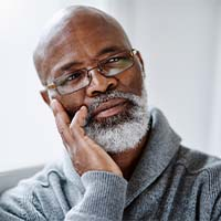 mature black man thinking
