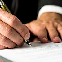 signing-document-suit-blog-square-200x200