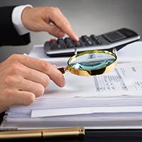 businessperson_examining_documents_blog_square_200x200