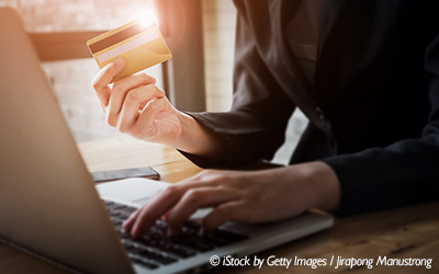 woman_holding_credit_card_at_laptop_blog_horizontal_400x250