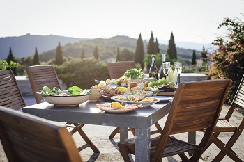Passport-dinner-with-view-hills-iStock-611075624-350x233